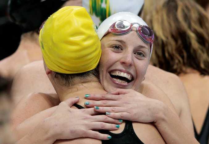 The Australian team celebrate winning the women's 400 metre freestyle relay final.