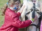 Tiana Skinner with pony at Rangeville Community Church centenary celebrations. Photo Nev Madsen / The Chronicle