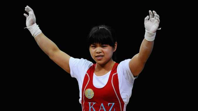 Teenager Zulfiya Chinshanlo has broken Olympic and world records on her way to gold in the women's 53 kilogram weightlifting.