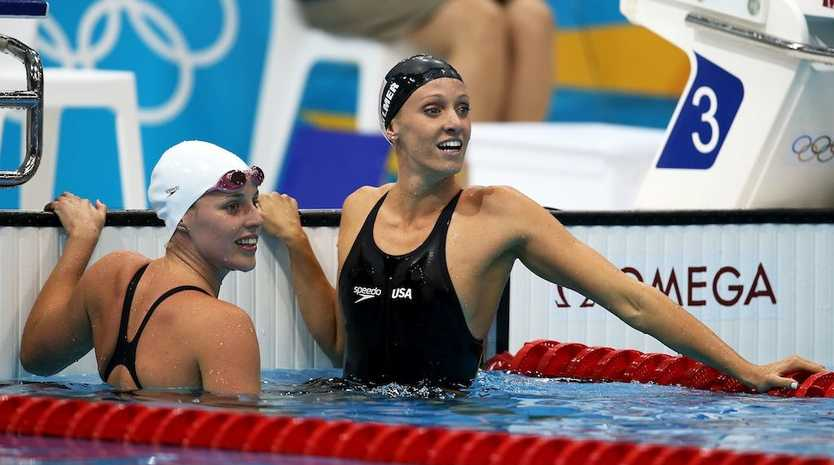 Alicia Coutts (left) finishes third behind world record breaker Dana Vollmer (right).