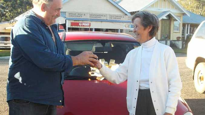 Marty Clapp from Auto Top Trade car dealership in Lismore presents Mallanganee resident Betty Cundy with her Holden Barina.