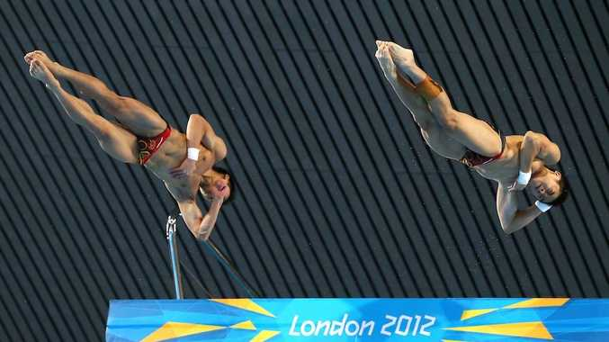 Yanquan Zhang and Yuan Cao have won gold in the men's diving.