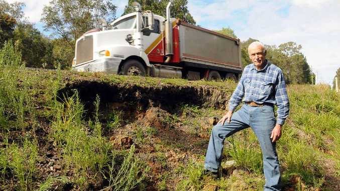 Ian Swan says embankments beside the Tin Can Bay Rd need to be fixed before the bitumen is undermined.