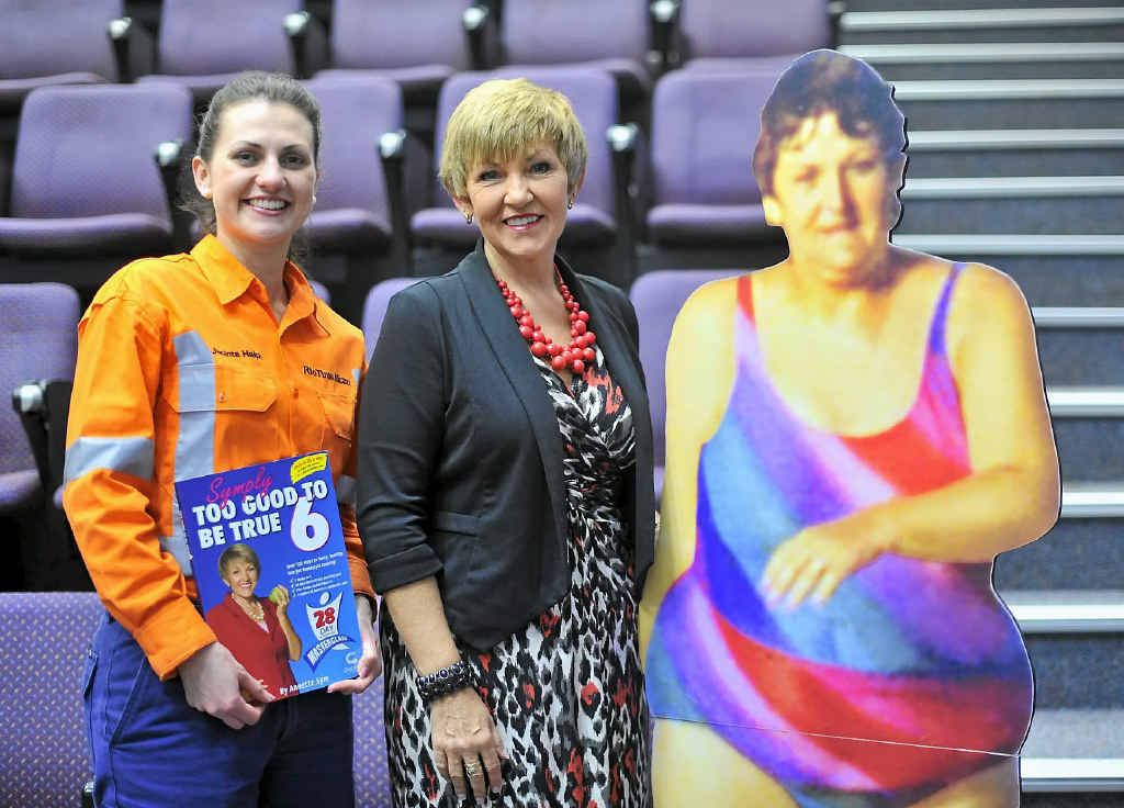 INSPIRATIONAL STORY: Rio Tinto Alcan community relations adviser Jacinta Halpin and Annette Sym next to a cut-out of Ms Sym, aged 37 and weighing 100kg.