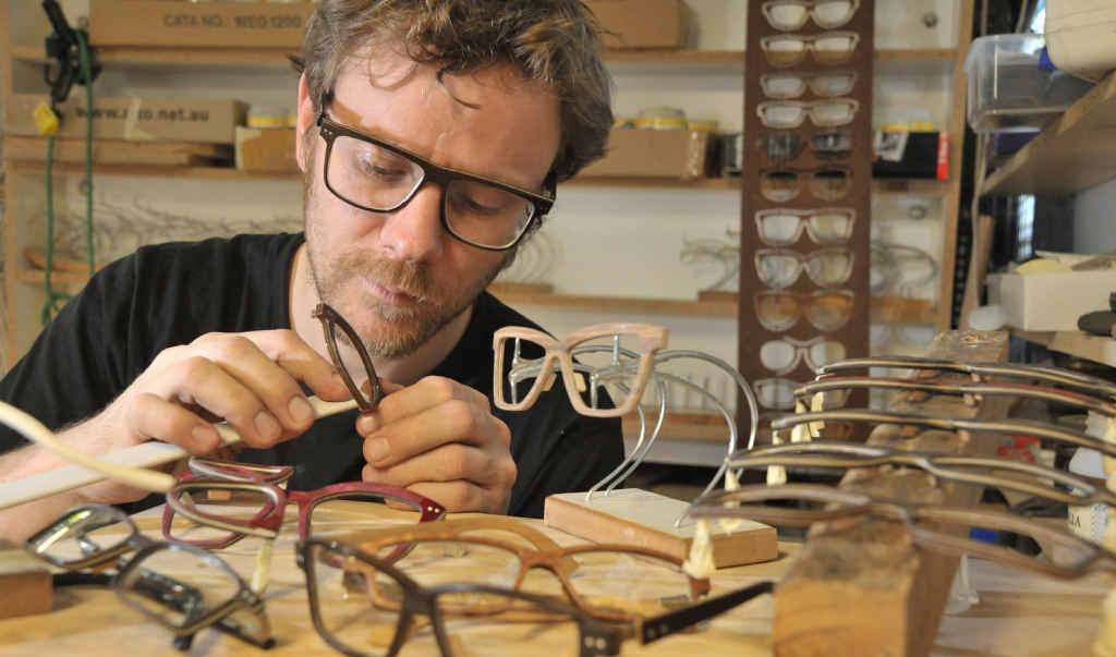 Former boat builder Fritz Schwarz, of Diddillibah, works on his special glasses.