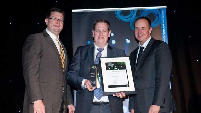 Ostwald Bros executive general Matthew Ostwald receiving the Employer of the Year award from Trevor Schwenke and Toowoomba North member Trevor Watts.  Photo Owen Studio