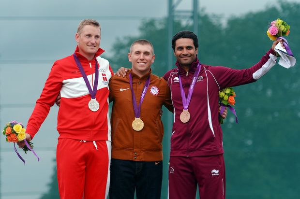 Vincent Hancock of the United States (middle) has won gold in the men's skeet.