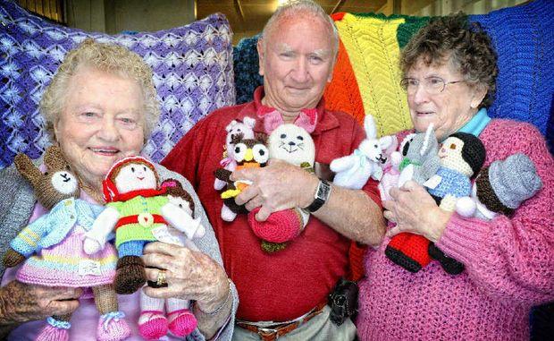 Minimart volunteers Val Wood, Kelvin Marsh and Ann Marsh were made life members on Tuesday.