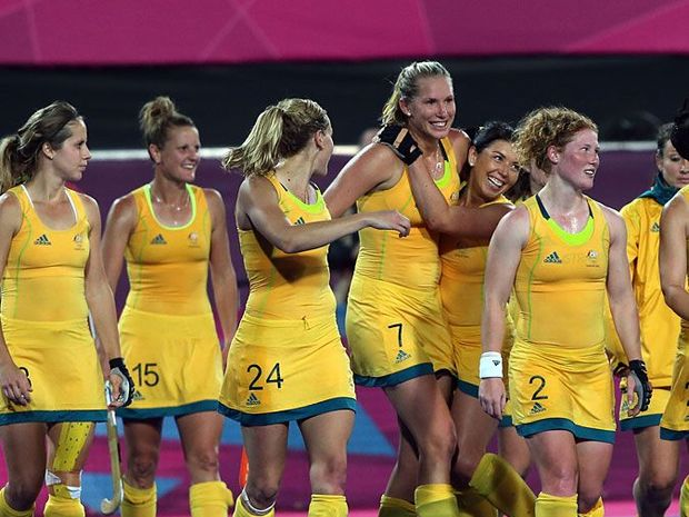 The Australia team celebrate after the Women's Hockey Match between Germany and Australia on day 4 of the London 2012 Olympic Games at Riverbank Arena on July 31, 2012 in London, England.