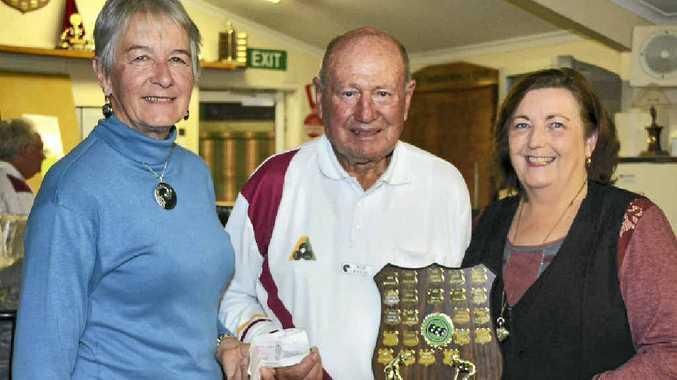 Representatives of the Boyne Tannum Meals on Wheels, Carolyn Murdoch (left) and Julieanne Matzkor (far right), receiving a cheque from Bob Baker on behalf of the bowls club.