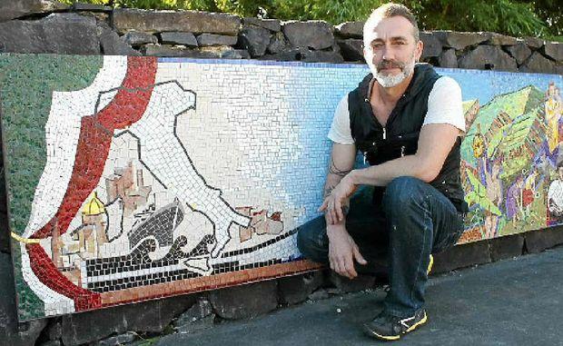 MIGRANT JOURNEY: Mosaic artist Scott Harrower with the new Italian monument.