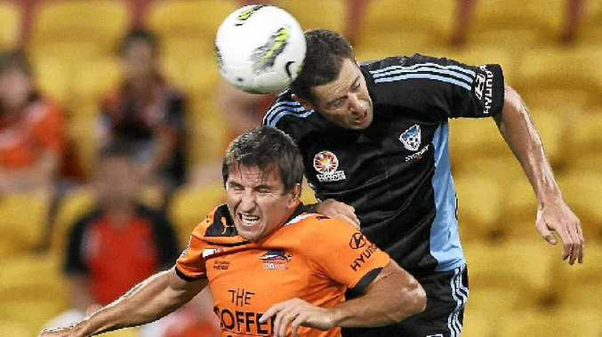 The Roar's Shane Stefanutto (left) and Brett Emerton of Sydney challenge for the ball during an A-League match. The teams will clash in a pre-season trial at Mackay's Virgin Australia Stadium next month.
