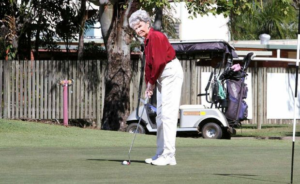 Marg Swaysland practices her putting at the Yeppoon Golf Club yesterday.