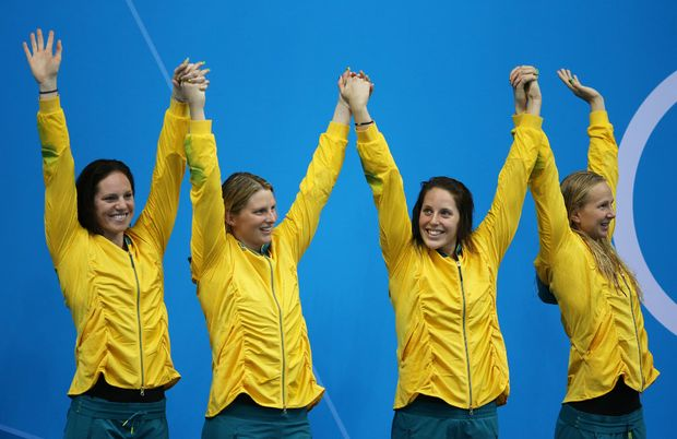 Silver medallists (L-R) Emily Seebohm, Leisel Jones, Alicia Coutts and Melanie Schlanger of Australia celebrate on the podium during the medal ceremony for the Women's 4x100m Meldey Relay Final