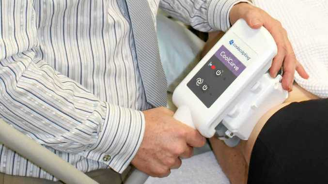 COOL HANDS: Dr Craig Layt with the CoolSculpting machine which freezes and kills fat cells.
