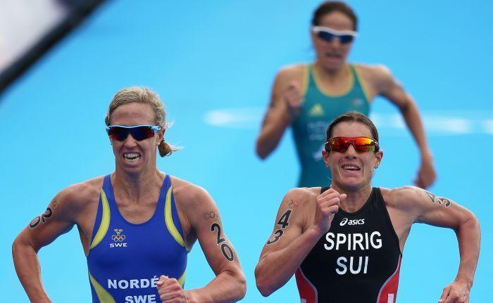 Erin Densham finishes behind Nicola Spirig (right) and Lisa Norden (left).