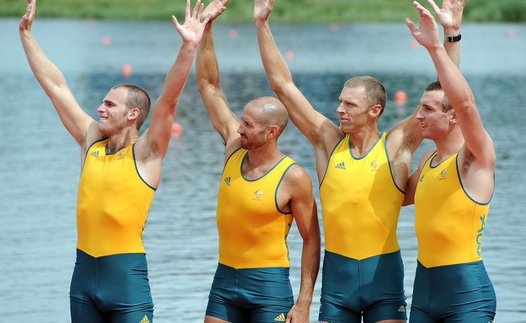 William Lockwood, James Chapman, Drew Ginn and Joshua Dunkley-Smith of Australia celebrate before receiving their silver medals during the medal ceremony for the Men's Four Final on Day 8 of the London 2012 Olympic Games