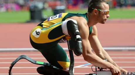 In better times: Oscar Pistorius prepares to race during the London Olympics