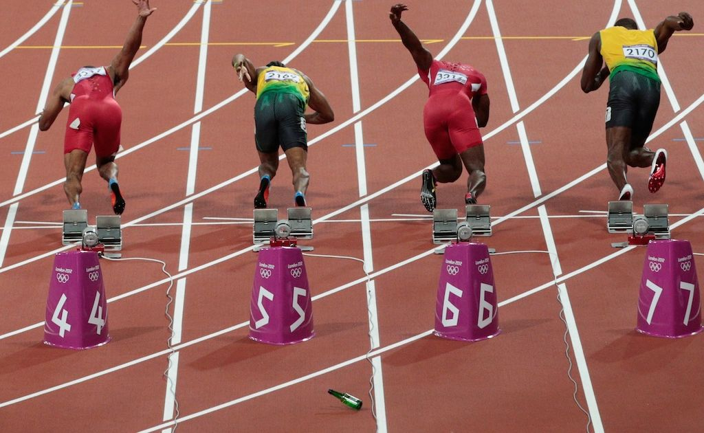 A spectator allegedly threw a bottle onto the track of the men's 100 metre final.