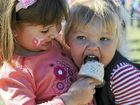 Zoey Anderson and Ella Clark share a strawberry ice-cream at Saturday's Strawberry Fair.