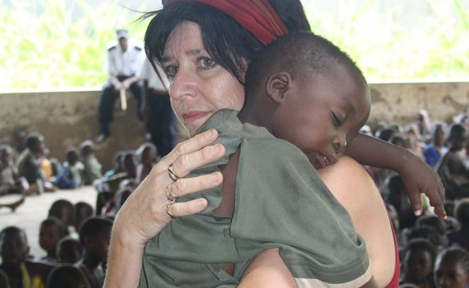 Bundaberg's Cathy Booth comforts a child at the Umoja Orphanage in Kenya.
