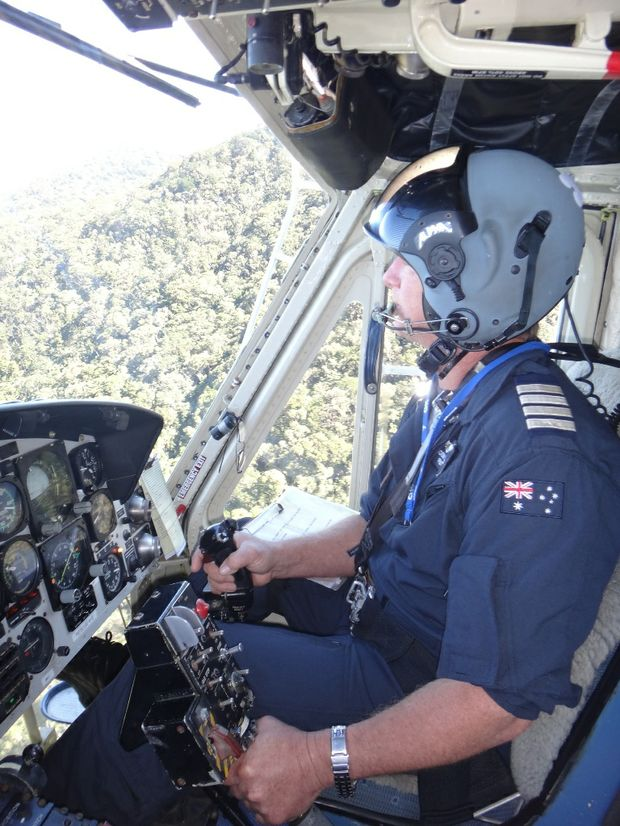RACQ-CQ Rescue pilot Brendon Barron performs an aerial search over sections of Mt Dalrymple for missing Marian man Sean Russell.