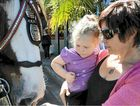 Katie Dahl, two, and her mum Sandra took a closer look at the Carlton United Brewers Clydesdale team in Grafton on Saturday.
