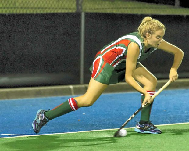 Maddy Richey pushing out during a penalty corner play for her Demons hockey club A-grade side.