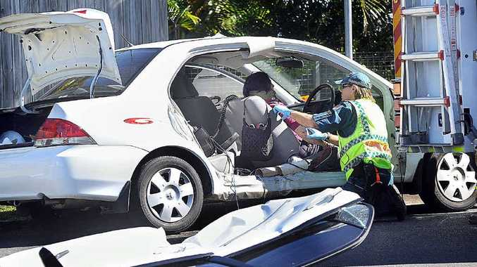 An 81-year-old driver is treated by paramedics after a crash at Torquay on Saturday.