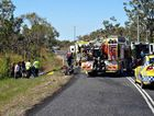 Emergency services crews at the scene of a crash near Midge Point where a Mackay woman had to have her right foot amputated yesterday.