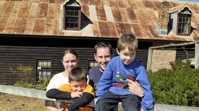 Renita, Brayden (8), Brett, and Jacob (5) Cross visit the Royal Bull's Head Inn at an open day yesterday.