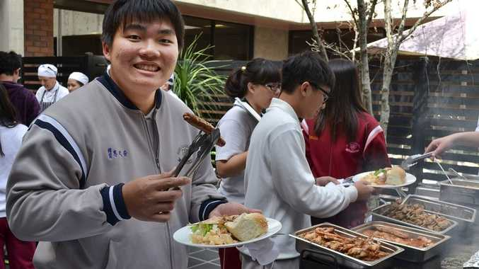 Student Jerry enjoys an Aussie barbecue held at SQIT.