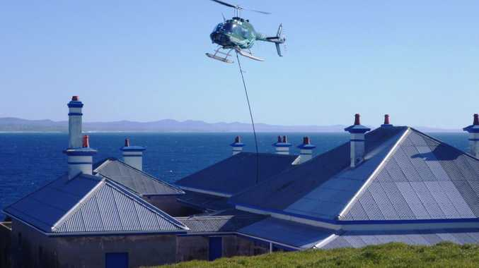 Renovations are underway at South Solitary Island to improve the lighthouse and adjoining buildings.