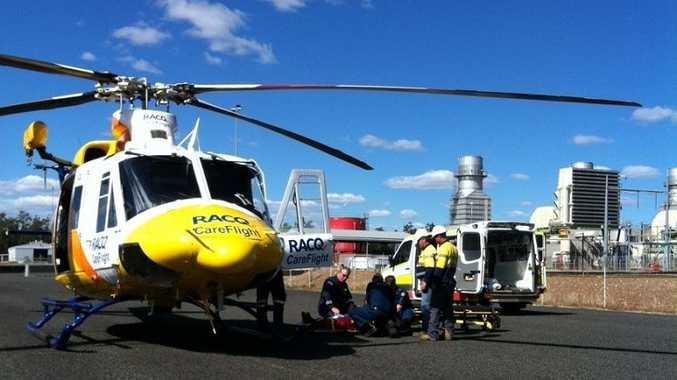 RACQ CareFlight crews treat a 79-year-old man who fell from a grader cab near Kogan.
