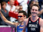 Alistair Brownlee leads home Spaniard Javier Gomez in the men's triathlon.