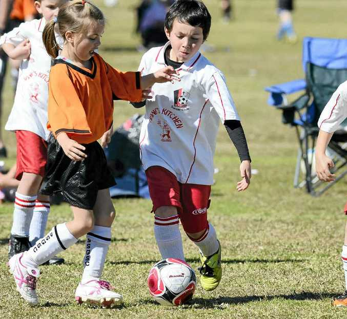 Souths' Jaykila O'Drisscoll (left) and Majos' Anthony Green during their under-8 match at the junior football carnival at Rushforth Park on Sunday.