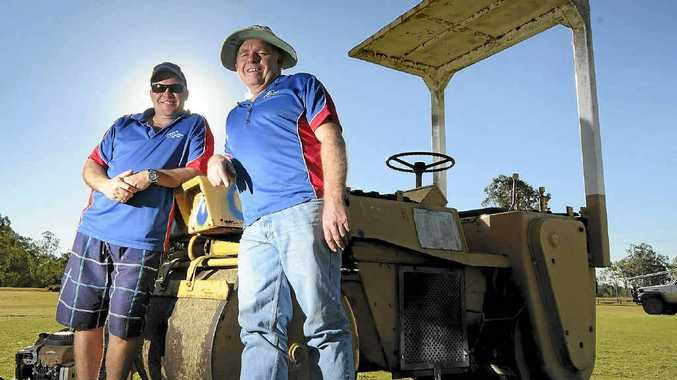 Chris Zielke, left, and Bruce Gibbs are getting the pitch ready for the arrival of the Wanders Queensland Club at Calliope Cricket Club.