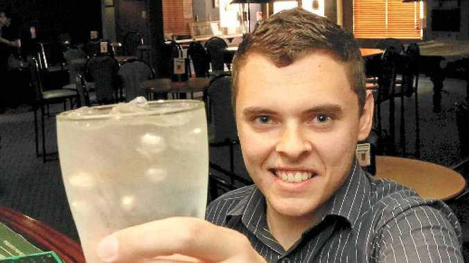 Malcolm Hewitt, 19, toasts with water as he attempts to stop drinking for three months.