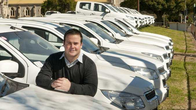 Ross Crampton Assistant General Manager Toowoomba Holden with huge stock of commercial vehicles.