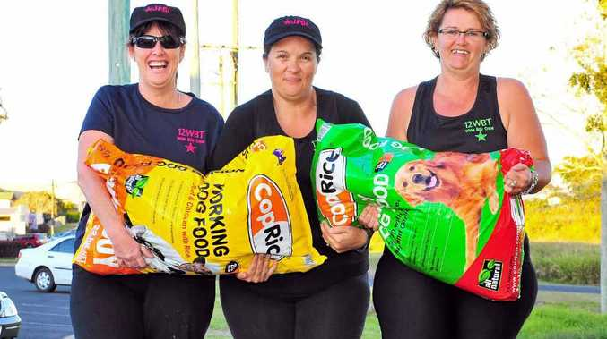 Donna Habermann, Kerri-Anne McNee and Kylie Lassig donated the amount of weight they have lost in dog food to the RSPCA after carrying it for 20km.