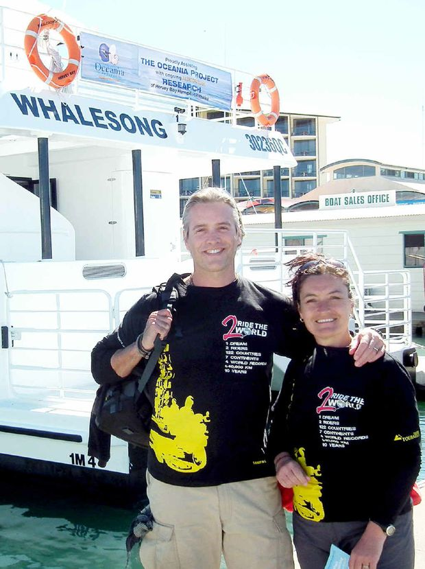 Simon and Lisa Thomas, stopping in Hervey Bay on their 400,000km motorbike ride to see the whales.
