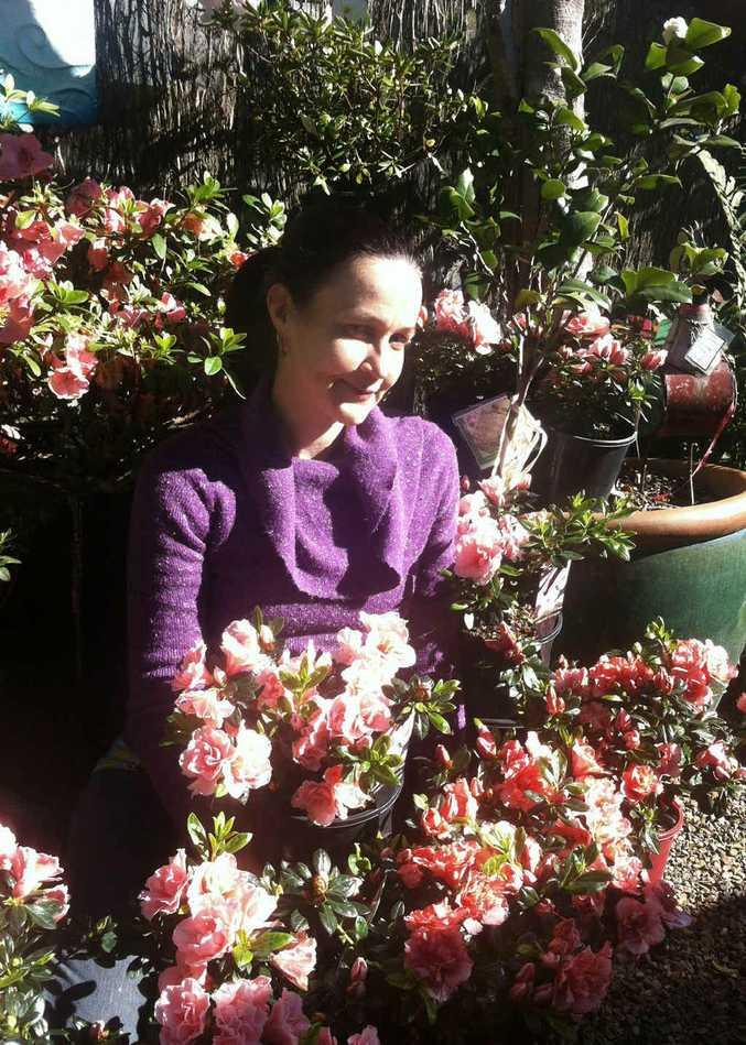 Chelsea van Rijn in the garden with some lovely Azaleas.