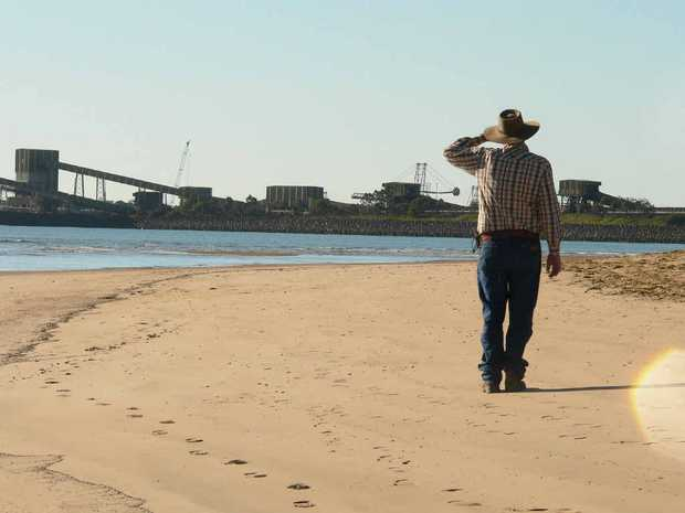 A landholder looks out at the Hay Point and Dalrymple Bay coal terminals.
