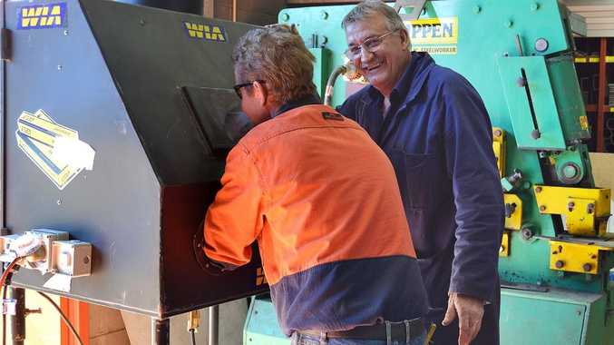 Apprentice boilermaker Craig Goebel (left) and SQIT metals and engineering teacher Peter Holmes demonstrate the try-a-trade welding simulator.