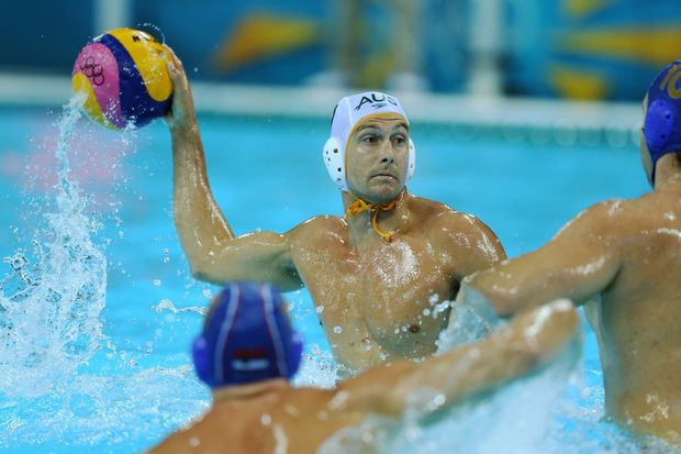 Australia has been defeated 11-8 by Serbia in the quarter-finals of the men's water polo.