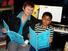 Mrs Carmel Stanley (President of the Gladstone Eisteddfod Association Inc) and Minada Gunaratne, 8 years, interrupted a piano lesson to be photographed while searching for Minada's name in the Gladstone Eisteddfod Programme.The Eisteddfod starts on Sunday, 12th August, 2012 at the Gladstone Entertainment Centre at 8.30 am.