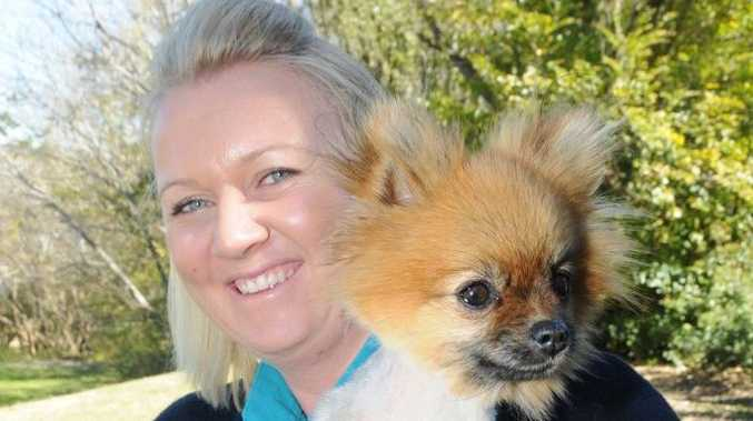 Sara Gruber and Pip the Pomeranian, shaved down to help protect against ticks.