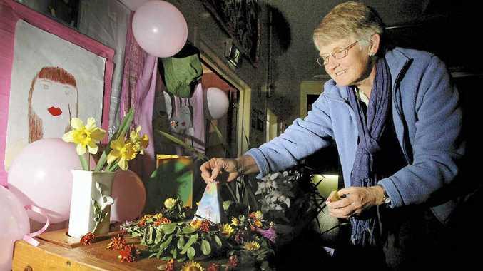 Sathya Sai former principal and teacher Kaye McNaught lights a candle for Paris.