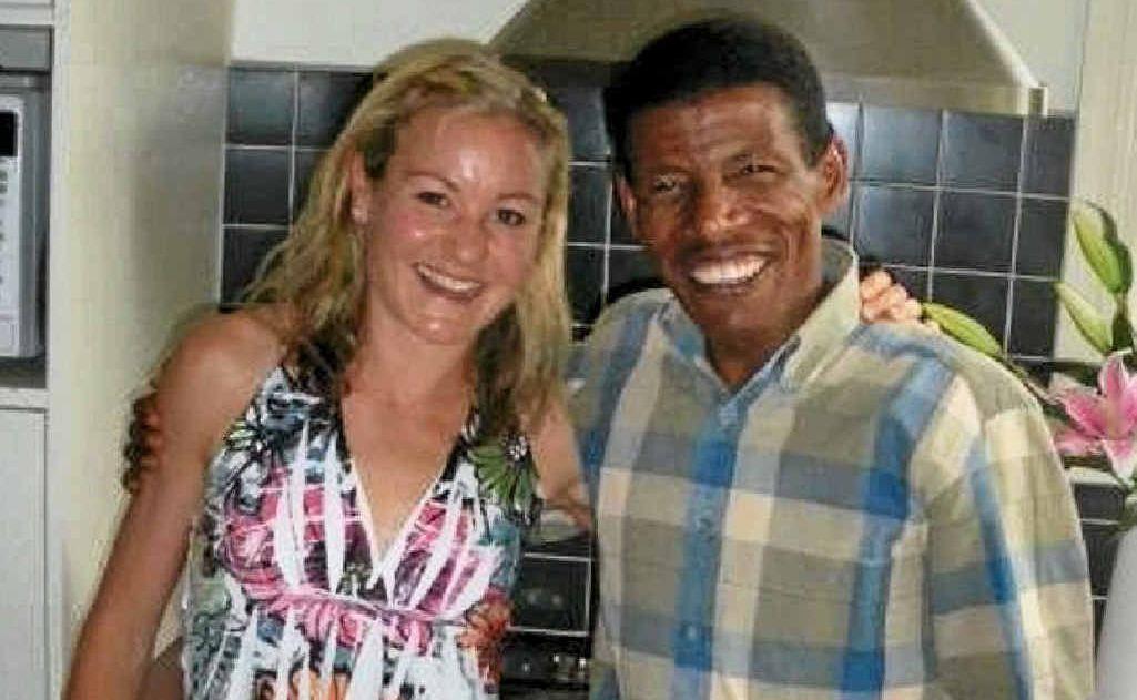Benita Willis poses with legendary Olympic athlete Haile Gebrselassie.