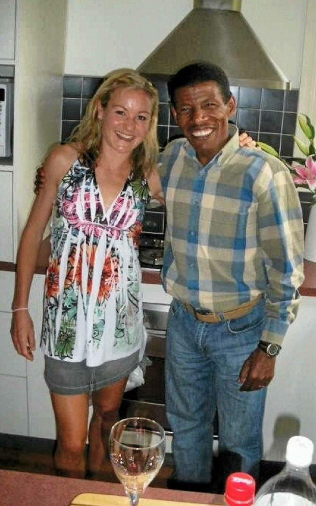 Benita Willis poses with legendary Olympic athlete Haile Gebrselassie.